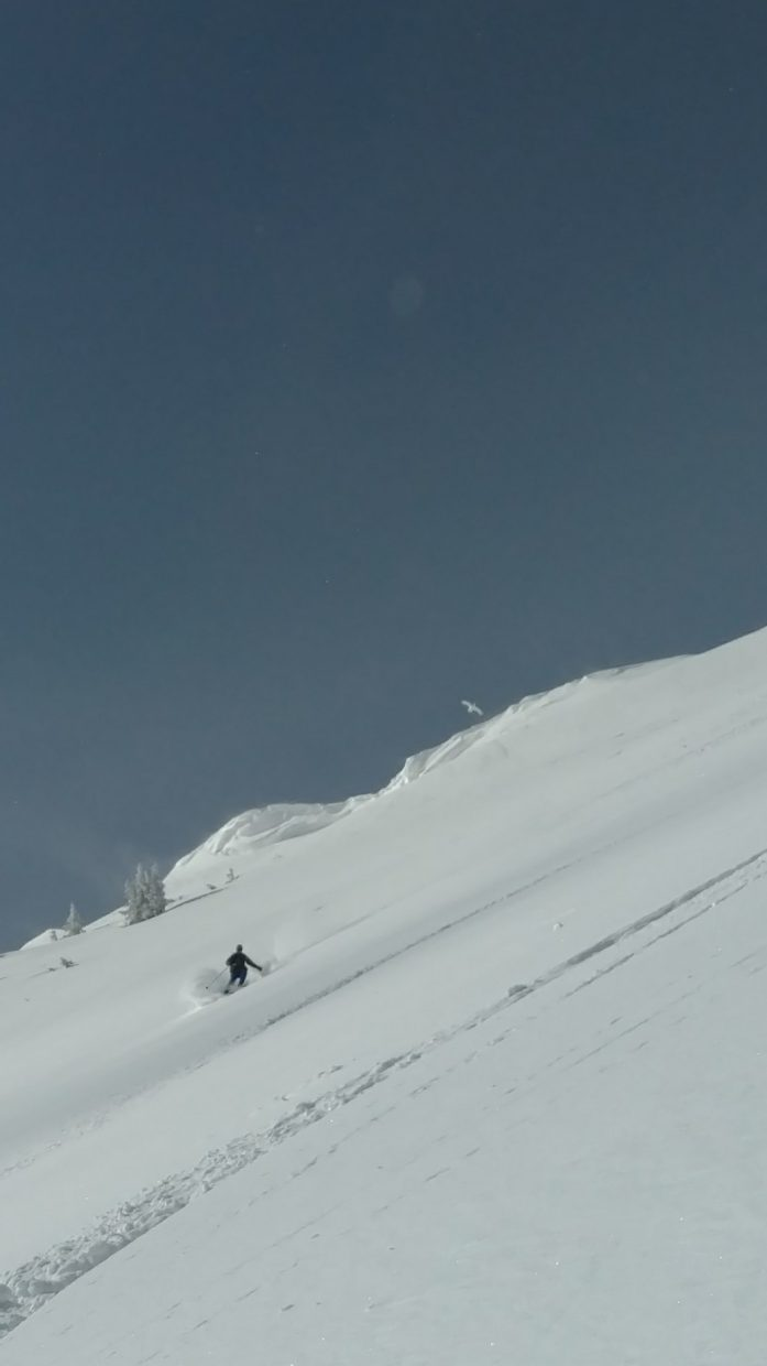 A skier skis down Cameron Pass.