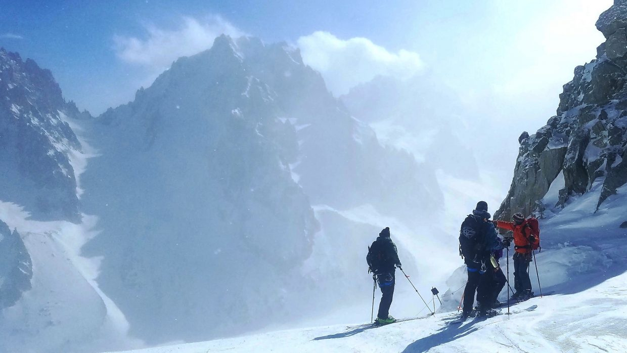 Skiers in Carlton's group wait to bomb down a slope in the French Alps late this winter.