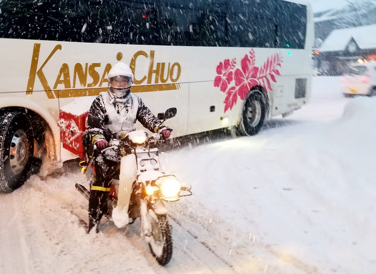 A mailman in Japan was deterred by the snow.