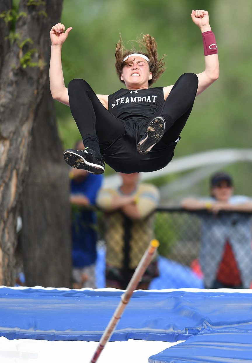 Steamboat Springs junior Eric Casey clinches his fists in celebration as he falls to the mat after clearing 14-0 in the Class 3A boys pole vault evnet at the state track and field championships in Lakewood.