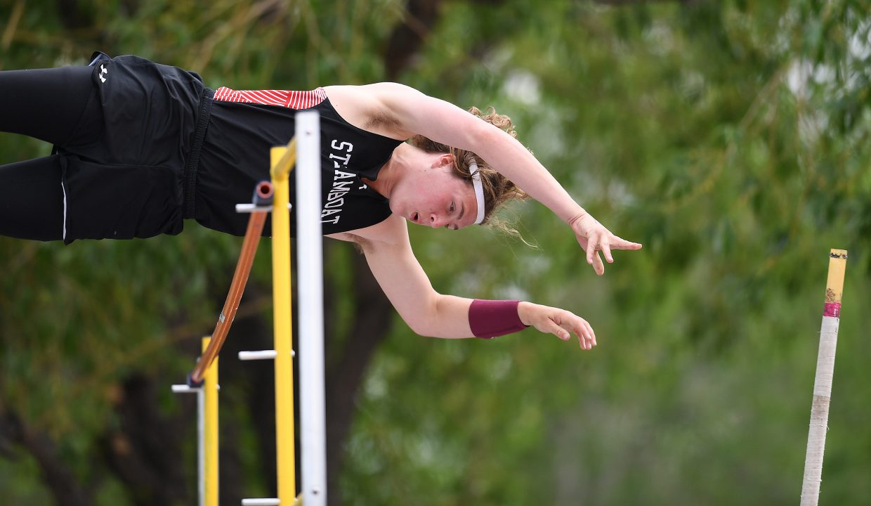 Eric Casey clears the bar Thursday during the 3A boys pole vault. He went on to win the event.