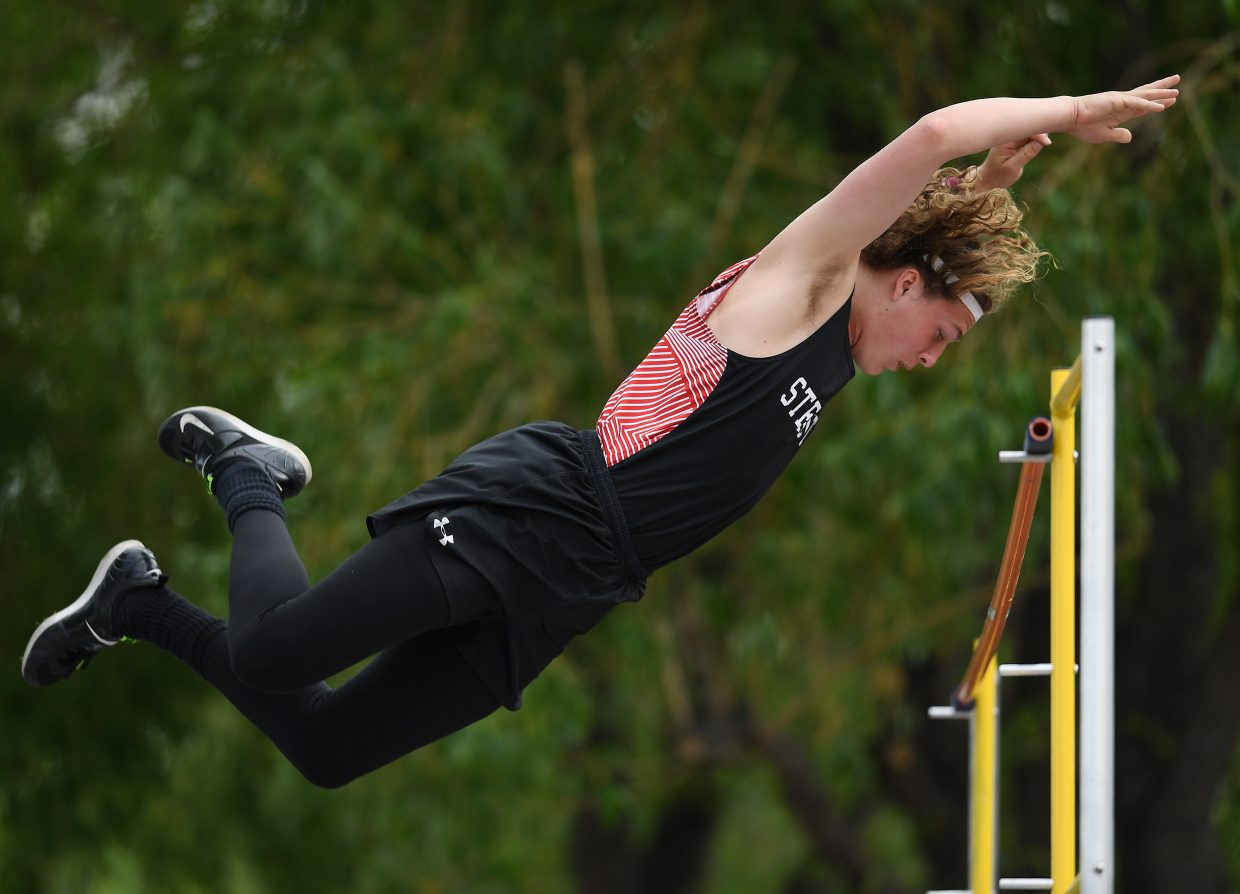 Steamboat pole vaulter Eric Casey soars above the bar Thursday at the state track meet.