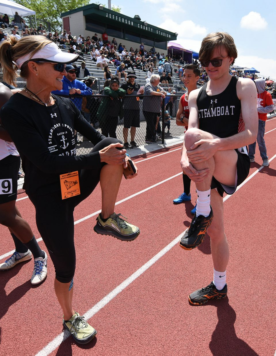 Steamboat coach Lisa Renee Tumminello and Jon Ruhle stretch before Ruhle's Friday race.