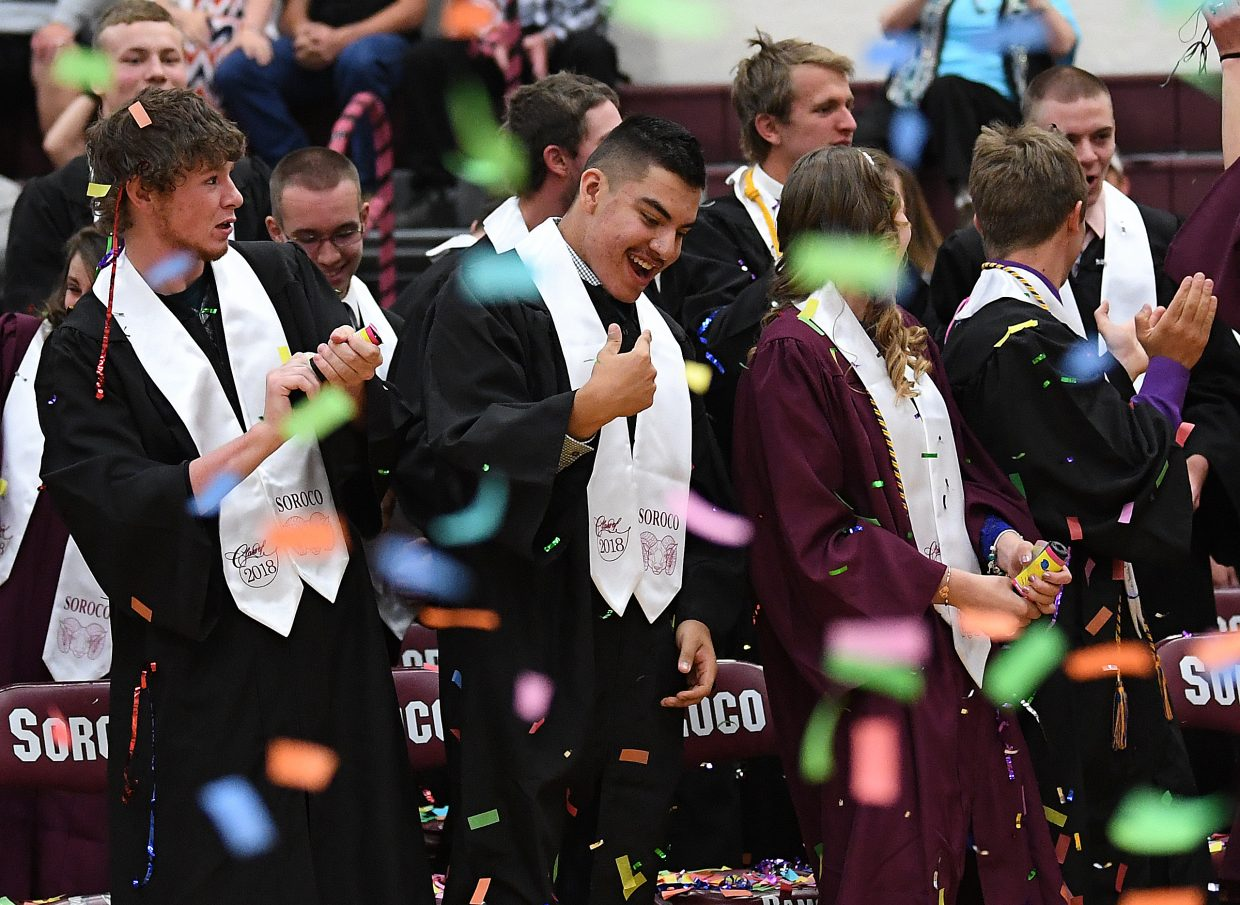 The Soroco High School Class of 2018 celebrates at the end of its graduation ceremony on Saturday in Oak Creek.