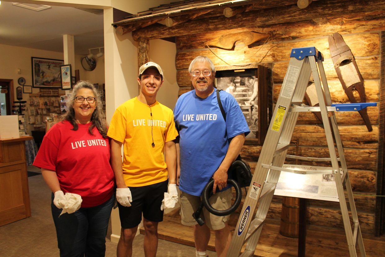 Volunteers assist at the Tread of Pioneers Museum during United Way's Day of Caring.