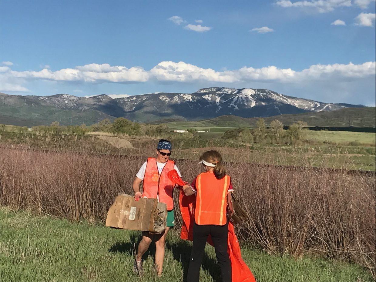 Tara Weaver and Debbie Aragon pick up trash during Routt County Clean-Up Day.