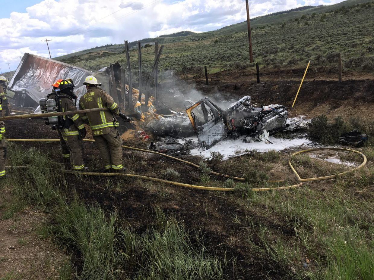 A tractor-trailer caught fire and started a small grass fire following a fatal crash with an SUV on May 30 about five miles outside of Kremmling. The driver of the SUV was pronounced dead at the scene.