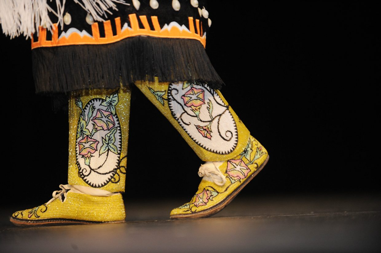Janik Murray dances with traditional moccasins and leggings during a performance Thursday at Steamboat Springs High School.