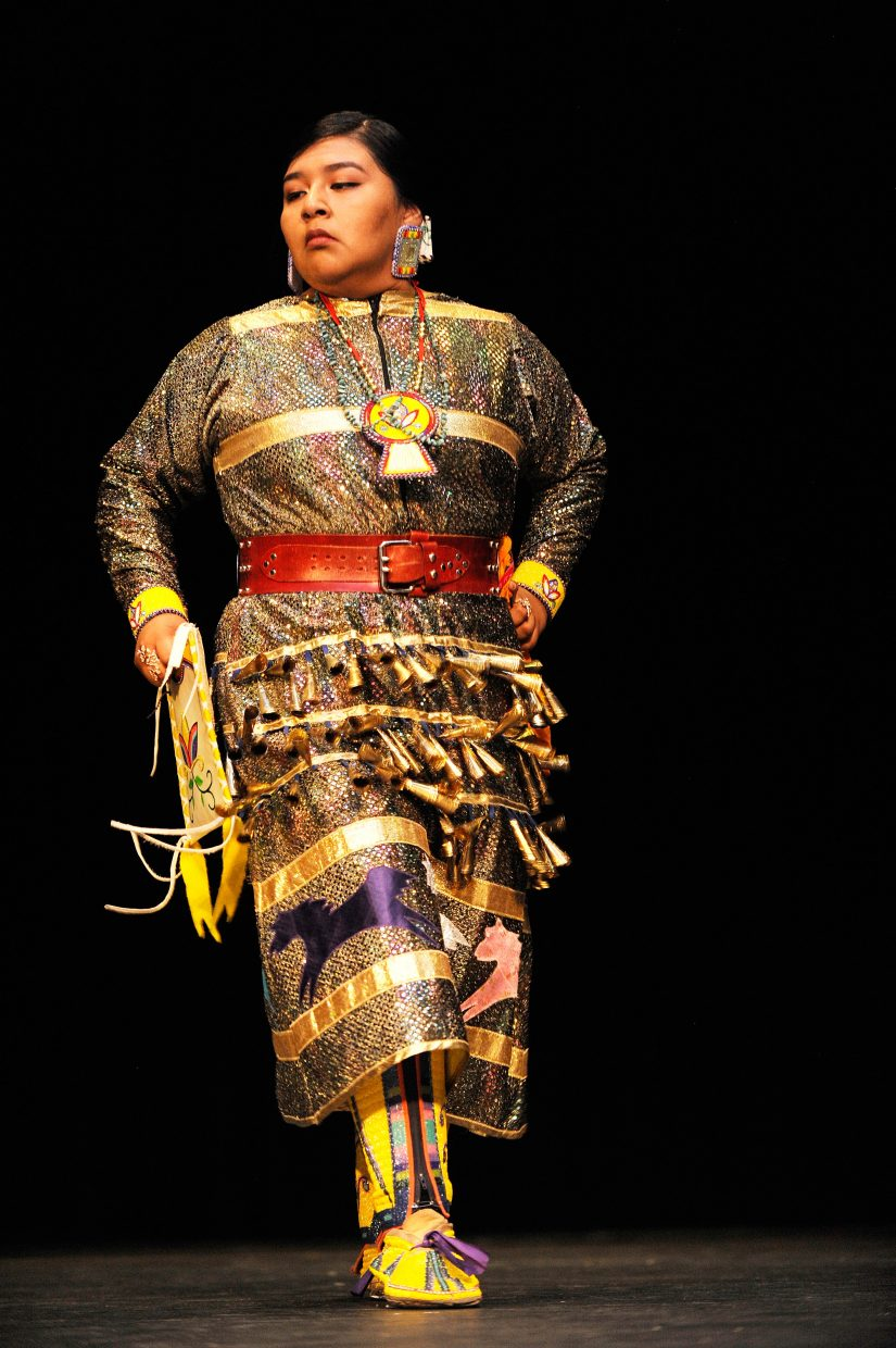 Youth Leadership Coalition of the Ute Indian Tribe member Dorice Burson performs the jingle dance.