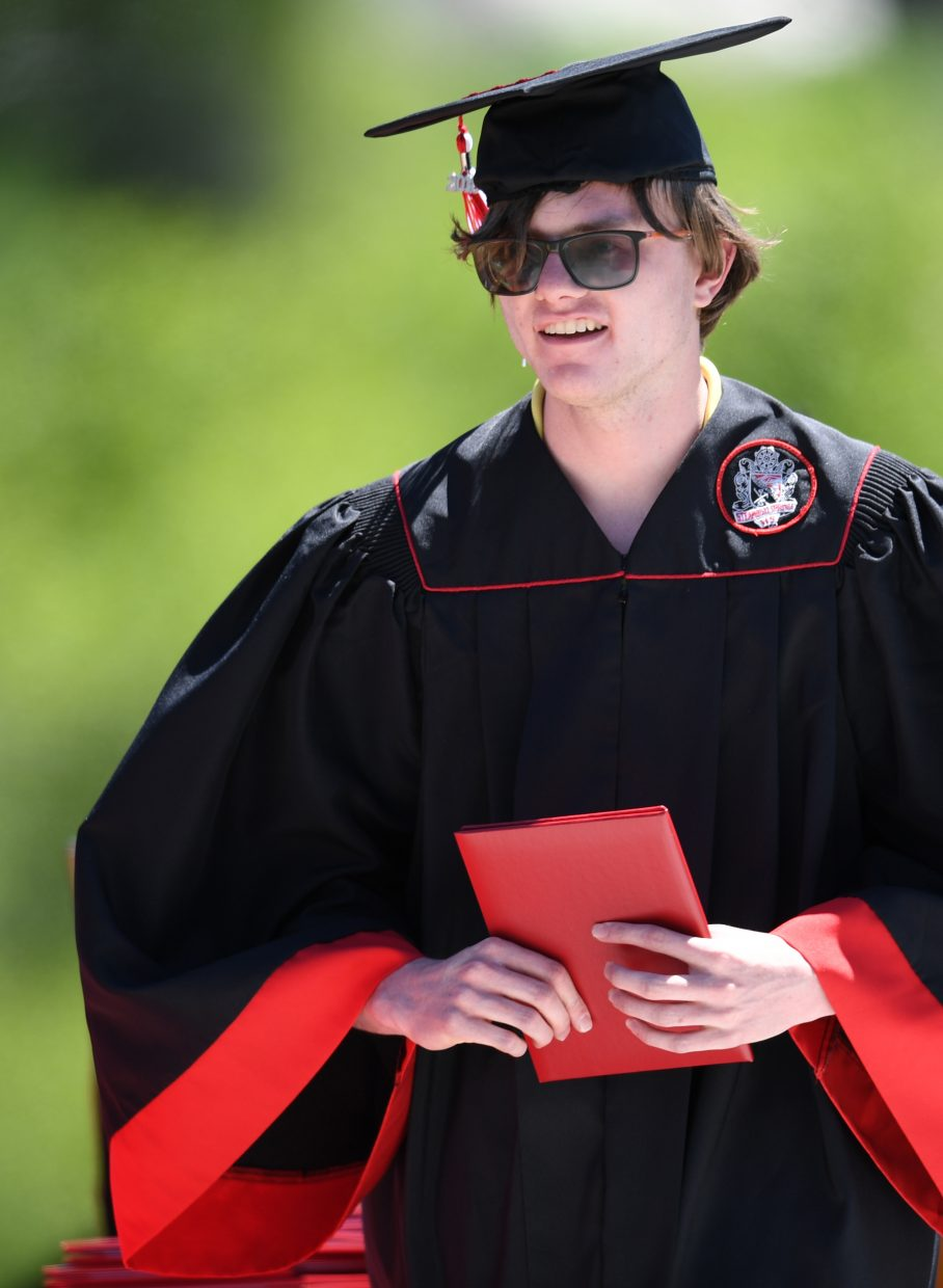 Jon Ruhle walks across the stage on Saturday at the Steamboat Springs High School graduation.