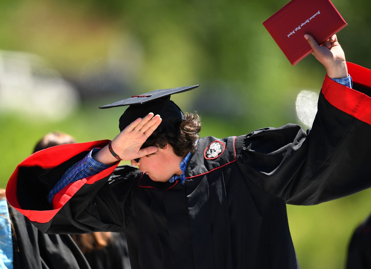 Alex Thompson dabs after receiving his diploma on Saturday during the 2018 Steamboat Springs High School graduation ceremony.