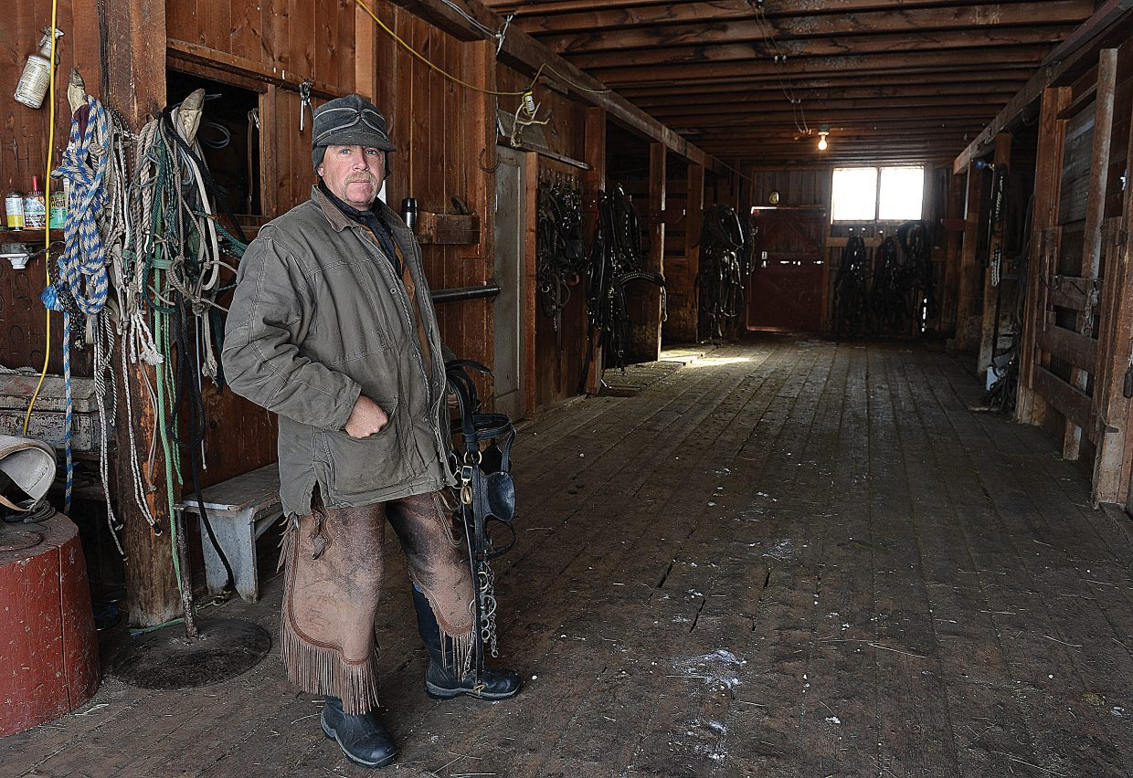 Rancher Matt Belton stands inside the main barn of the ranch he runs north of Steamboat Springs.