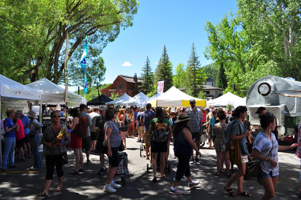 Shade provided some relief at Steamboat Springs Main Street Farmers Market on Saturday. This week kicked off the weekly summer tradition.