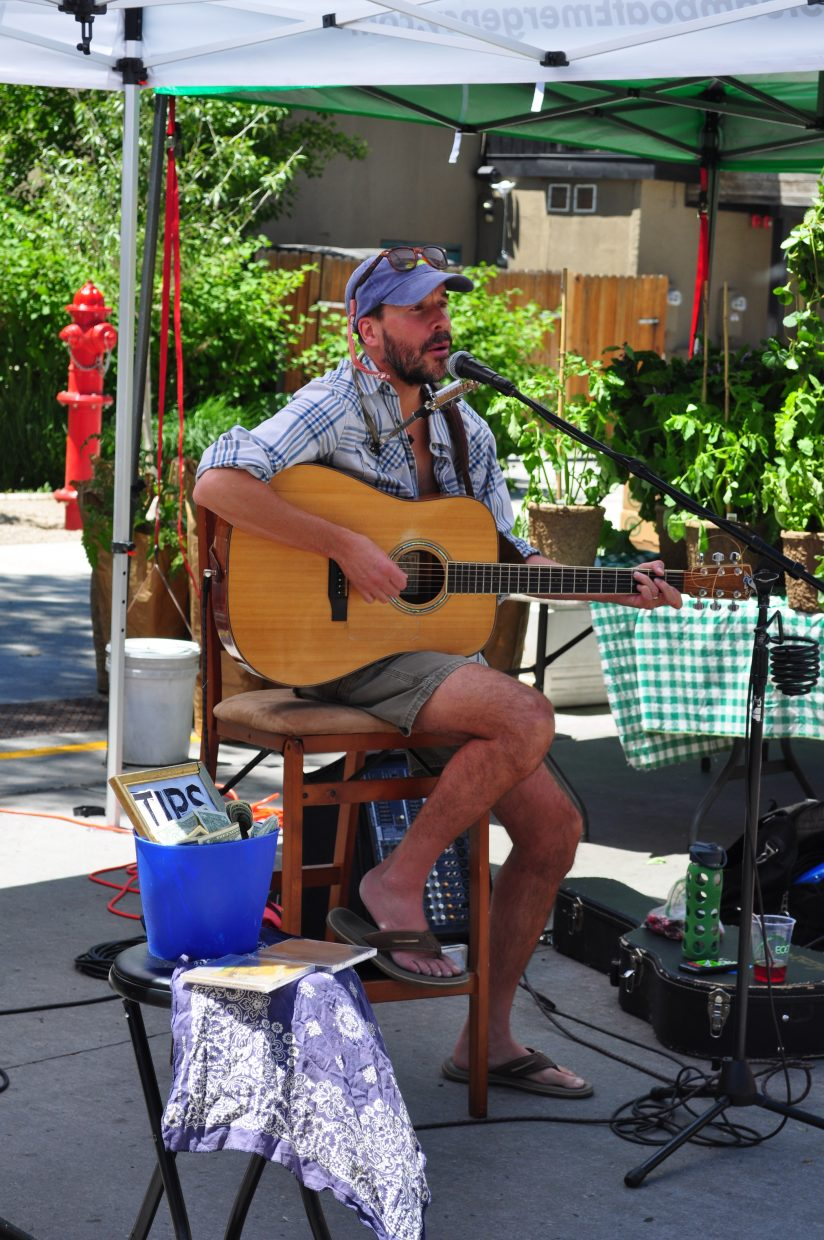 Local musician Trevor G. Potter provided live music at the Steamboat Farmers Market on Saturday.