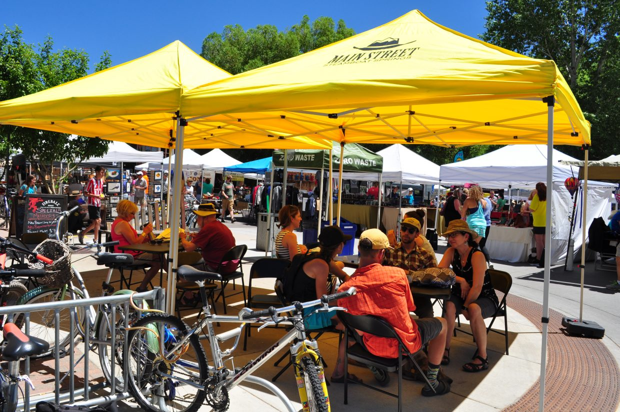 The Main Street Steamboat Springs shade tent was a relief for farmers market patrons on Saturday.