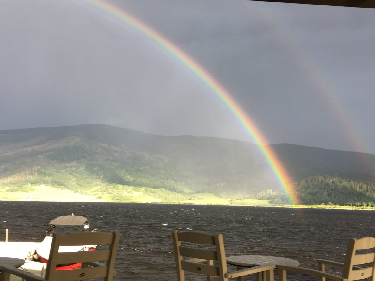 A rainbow appears over Catamount Lake.
