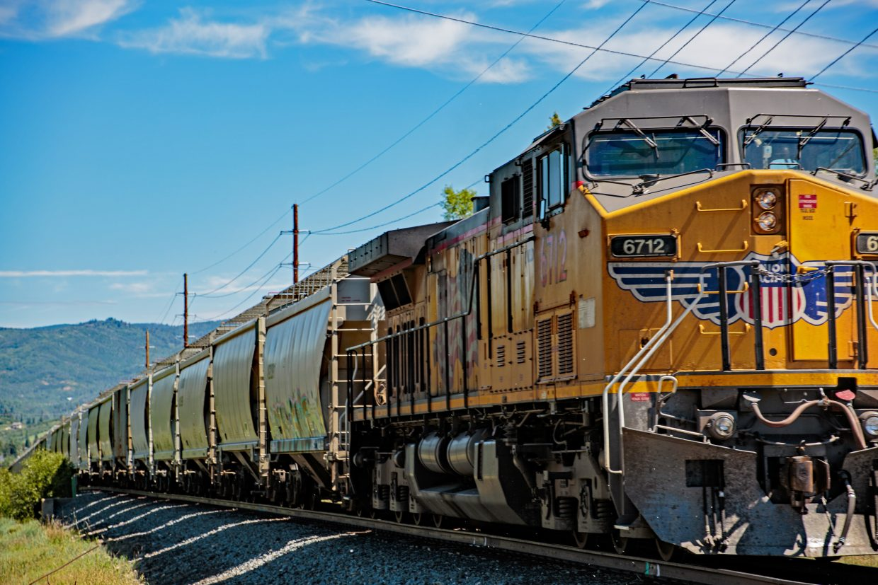 Long Union Pacific train winds its way through Steamboat. View is from Third Street to Fetcher Park Drive.