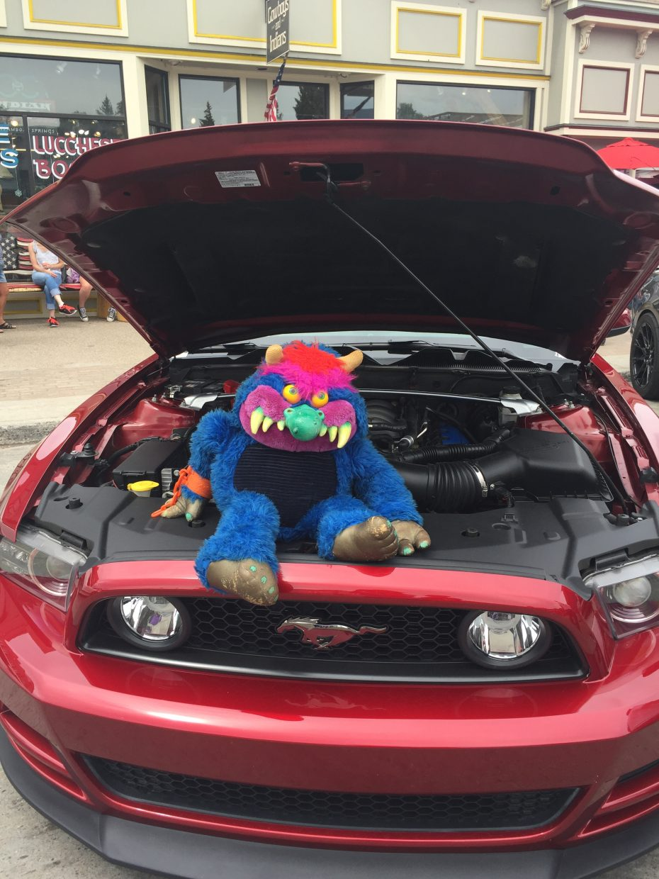 A stuffed monster sits on one of the mustangs at the Mustang Round-Up.