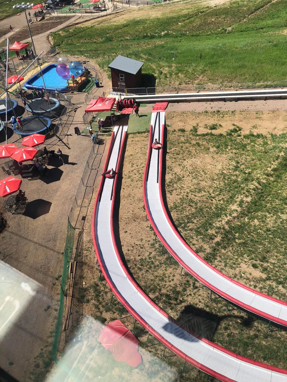 People ride the Rock & Roll Tubing Lanes, which is one of the attractions at The Land Up at the Steamboat Ski Area.