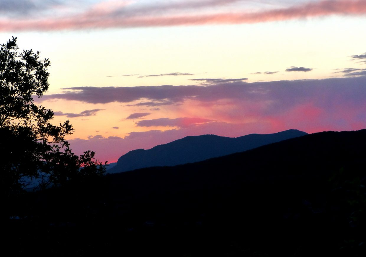 The Sleeping Giant Range, as the sun is setting behind him.