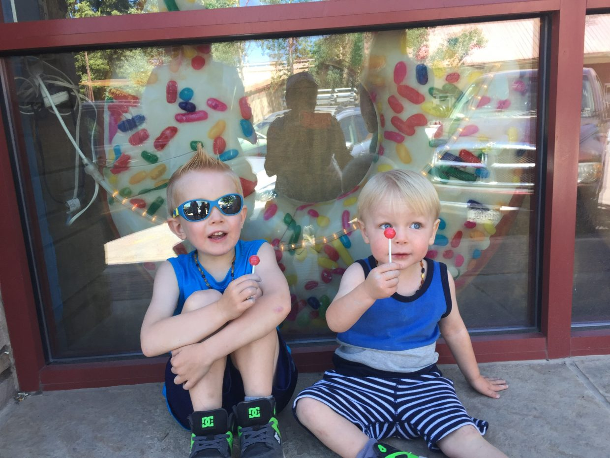 Two boys enjoy suckers in downtown Steamboat Springs.