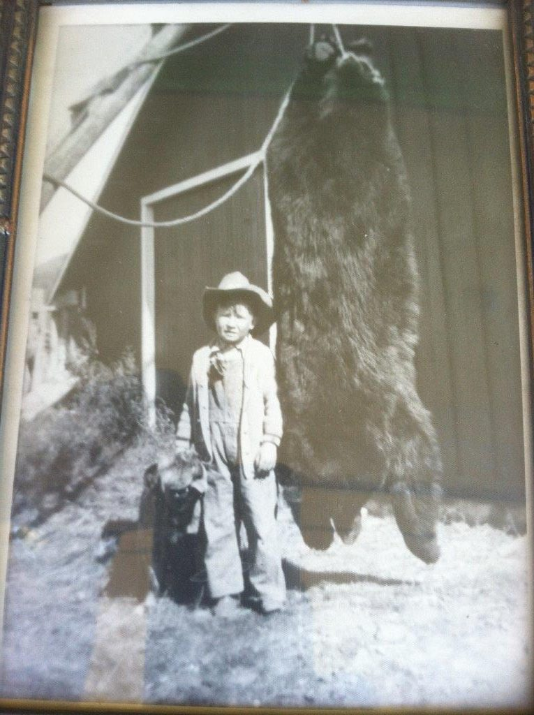 Young Don Brookshire standing in front of the Warren Ranch Barn with bear, circa 1929. Don's grandfather Ben Savage was a prior owner of the Warren Ranch.