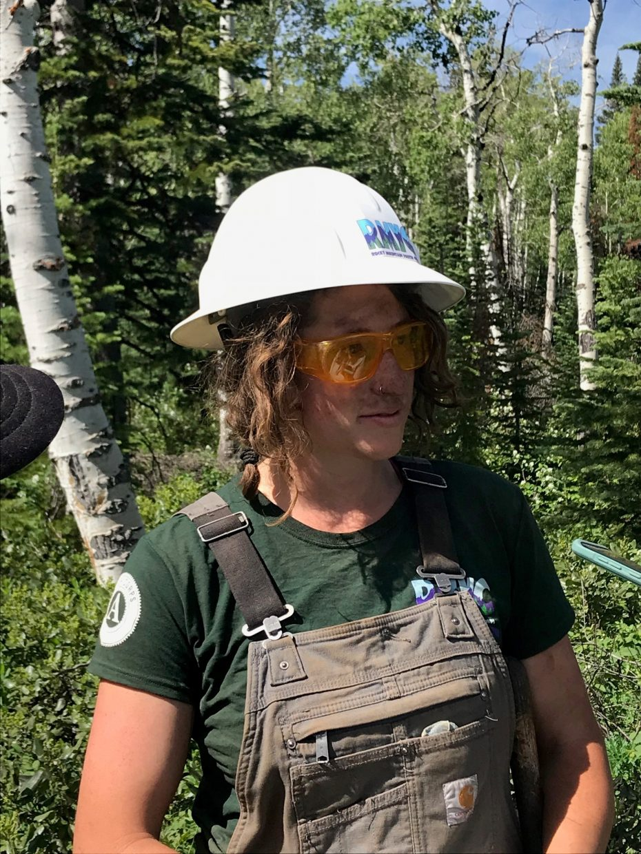 """The dust on Rocky Mountain Youth Corps crew leader Nomi Sherman shows you what it's all about as she checks on her """"amazing"""" young adults who spend up to 10 hours building and maintaining trails throughout public lands in Colorado and parts of Wyoming."""