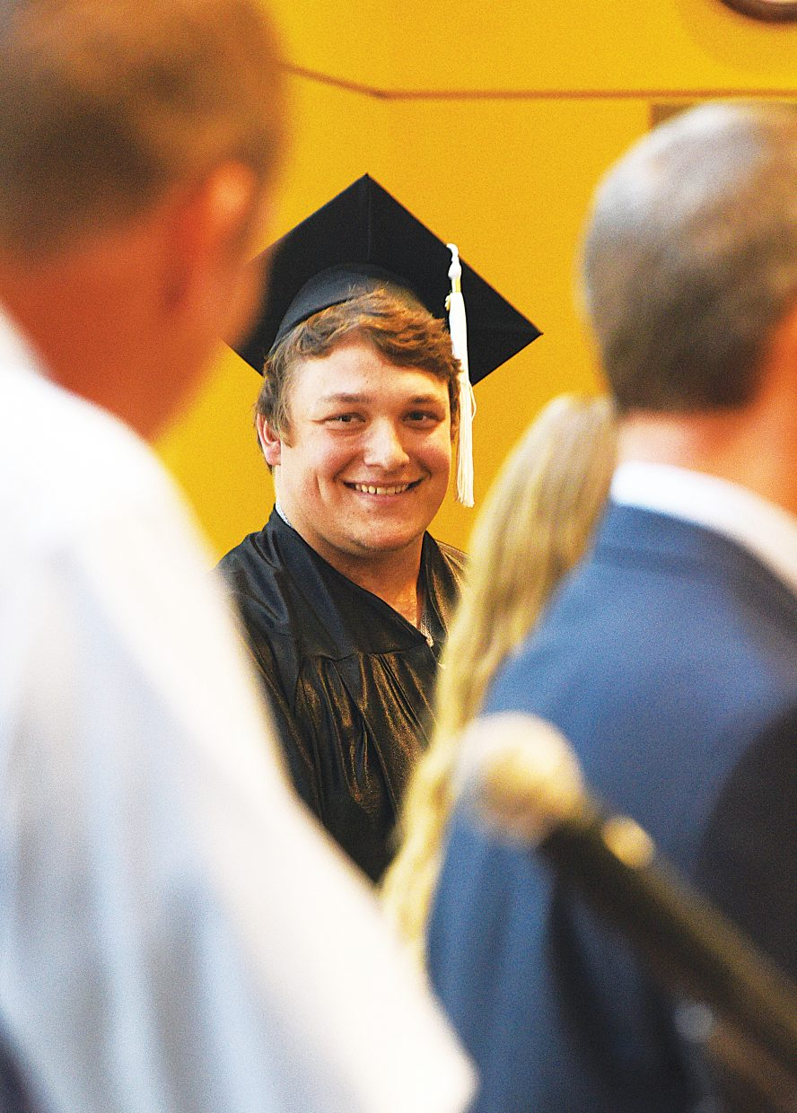 Tatum Wall smiles as his teacher Eric Bender reads a tribute to him at the Yampa Valley High School graduation Friday.