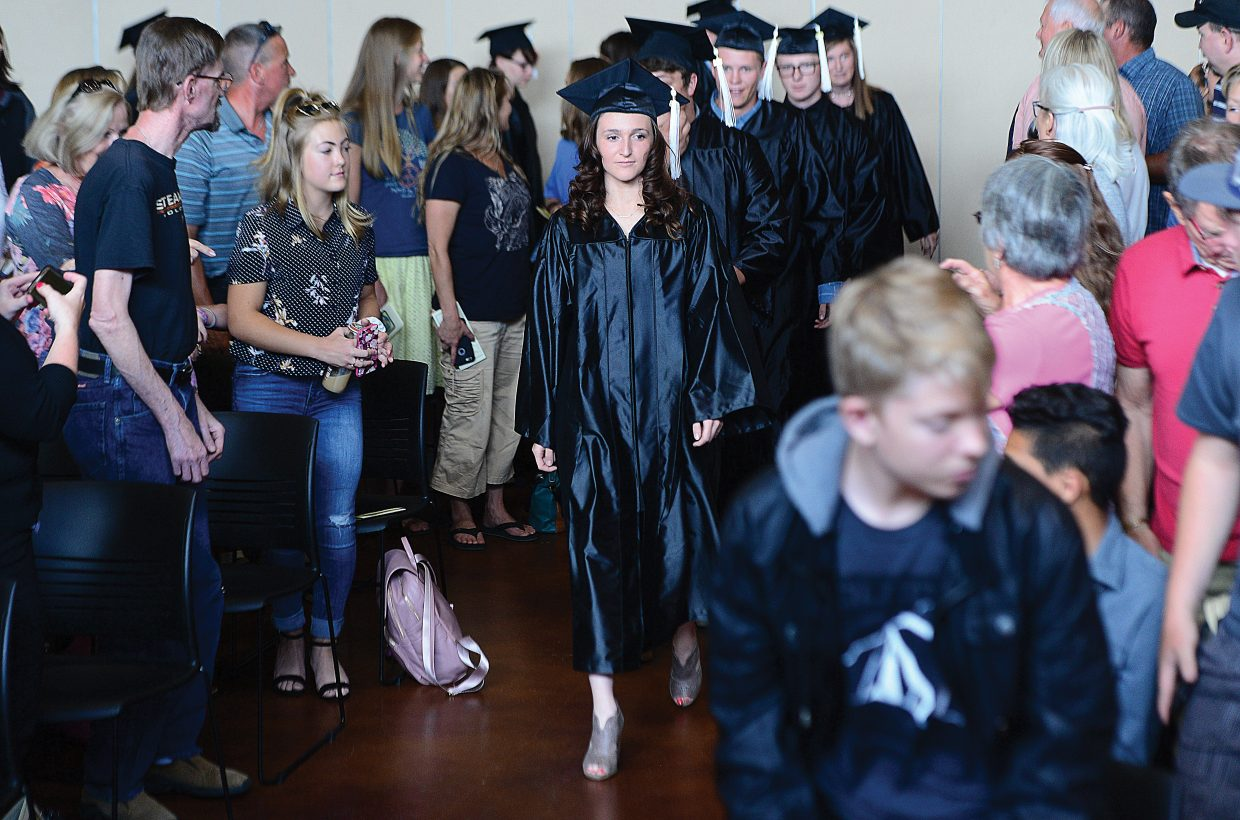 Yampa Valley High School senior Tyra Whitmore leads the school's class of 2018 into the Albright Auditorium on the Colorado Mountain College campus Friday afternoon. YVHS honored nine seniors in its commencement ceremony.