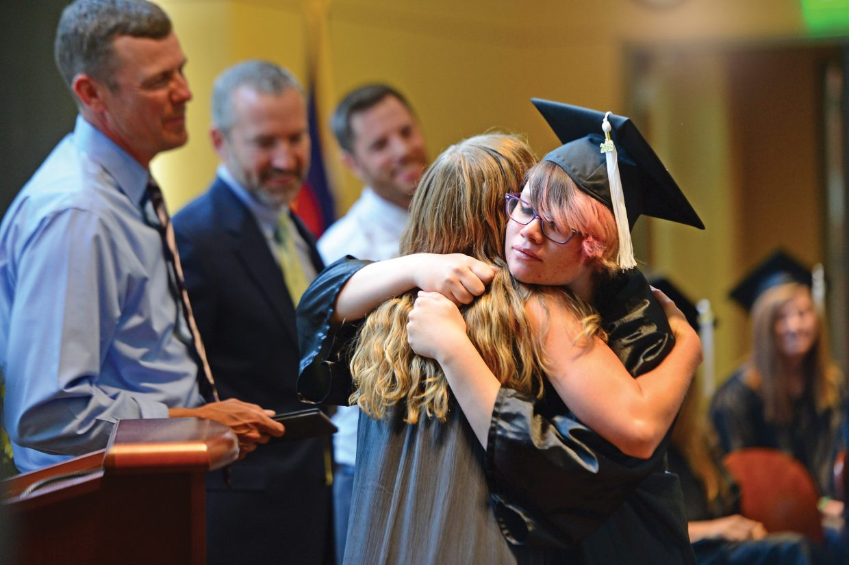 Haley Erickson gets a hug from Allison Wither during the 2018 Yampa Valley High School graduation.
