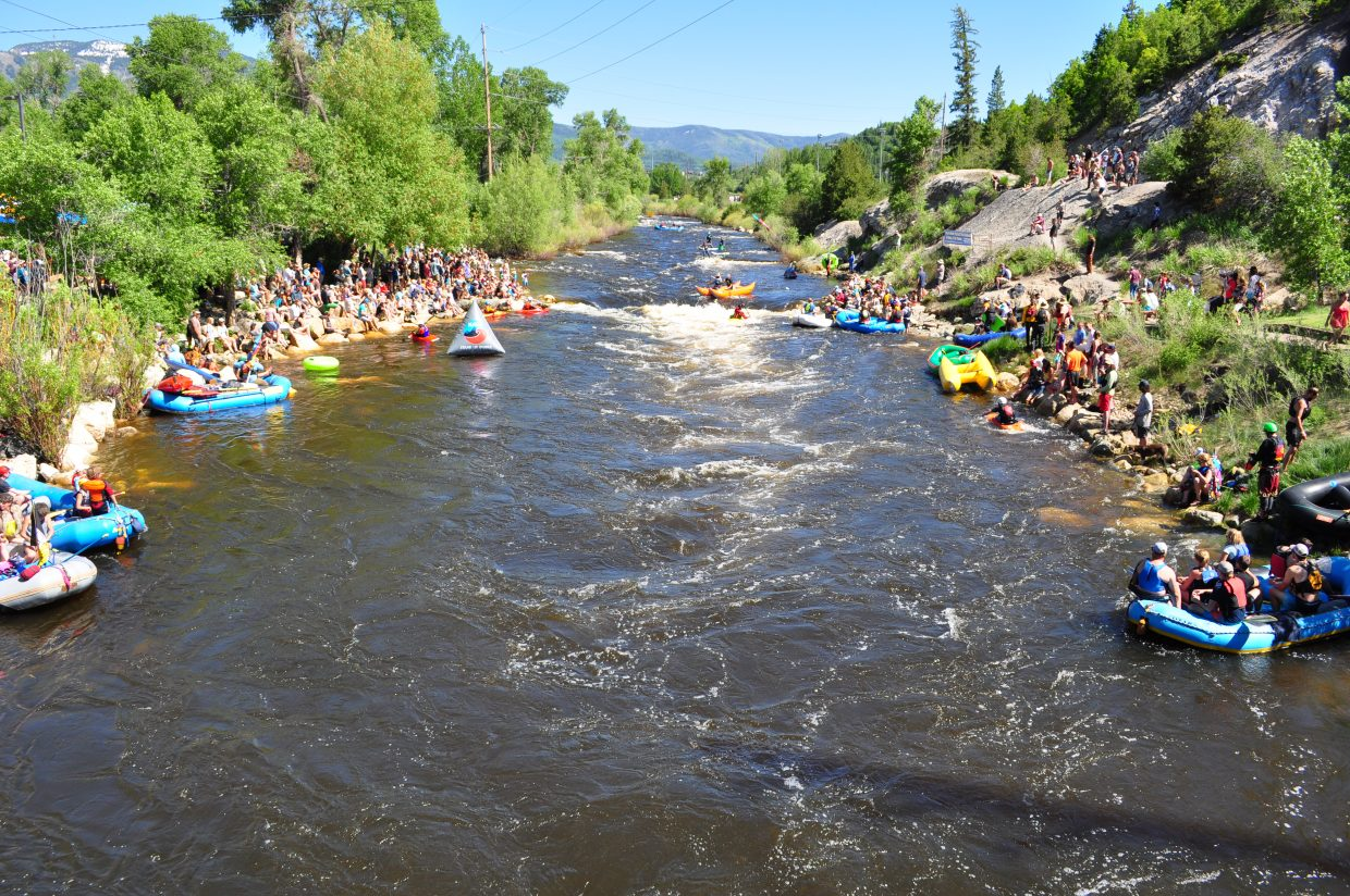 Crouwds gathered at Charlie's Hole on the Yampa River to watch events of the 2018 Yampa River Festival.
