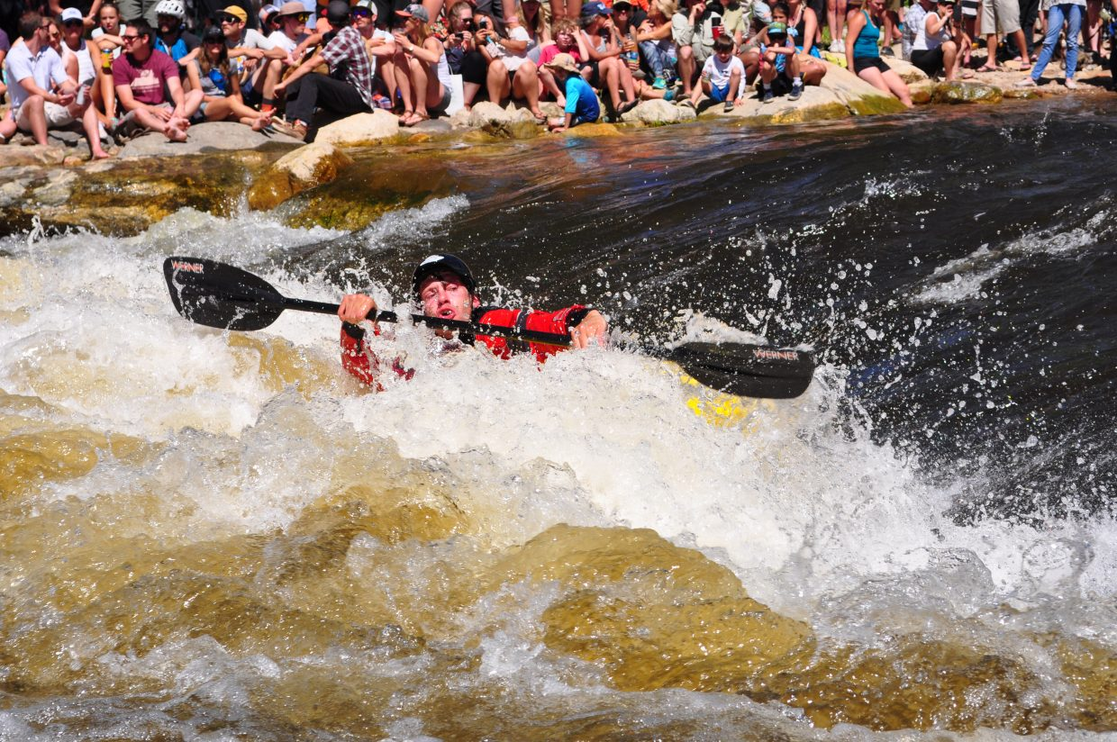 Kayakers show off their skills between rafts at the Yama River Festival on Saturday in Steamboat Springs.