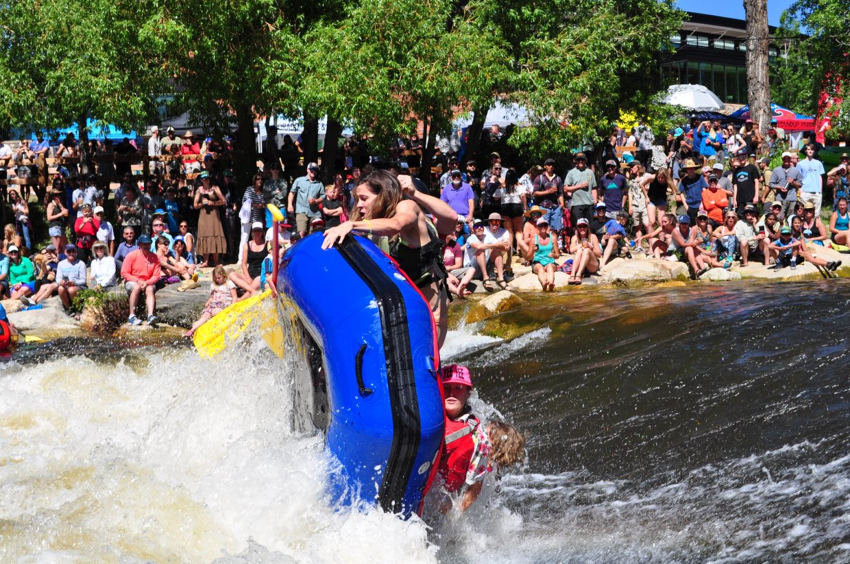 Rafters try their hand at surfing Charlie's Hole on the Yampa River by Bud Werner Memorial Library for the raft race and rodeo in Steamboat Springs on Saturday. Yampa River Festival continues Sunday with the kayak slalom race at noon.