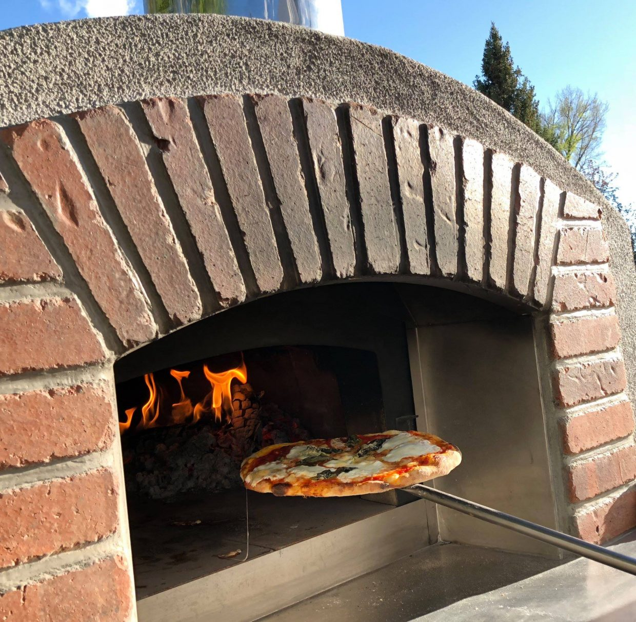 "Rustic wood-fire pizzas from Clyde's Pies Wood-Fired Pizza include ""Palisade Peach,"