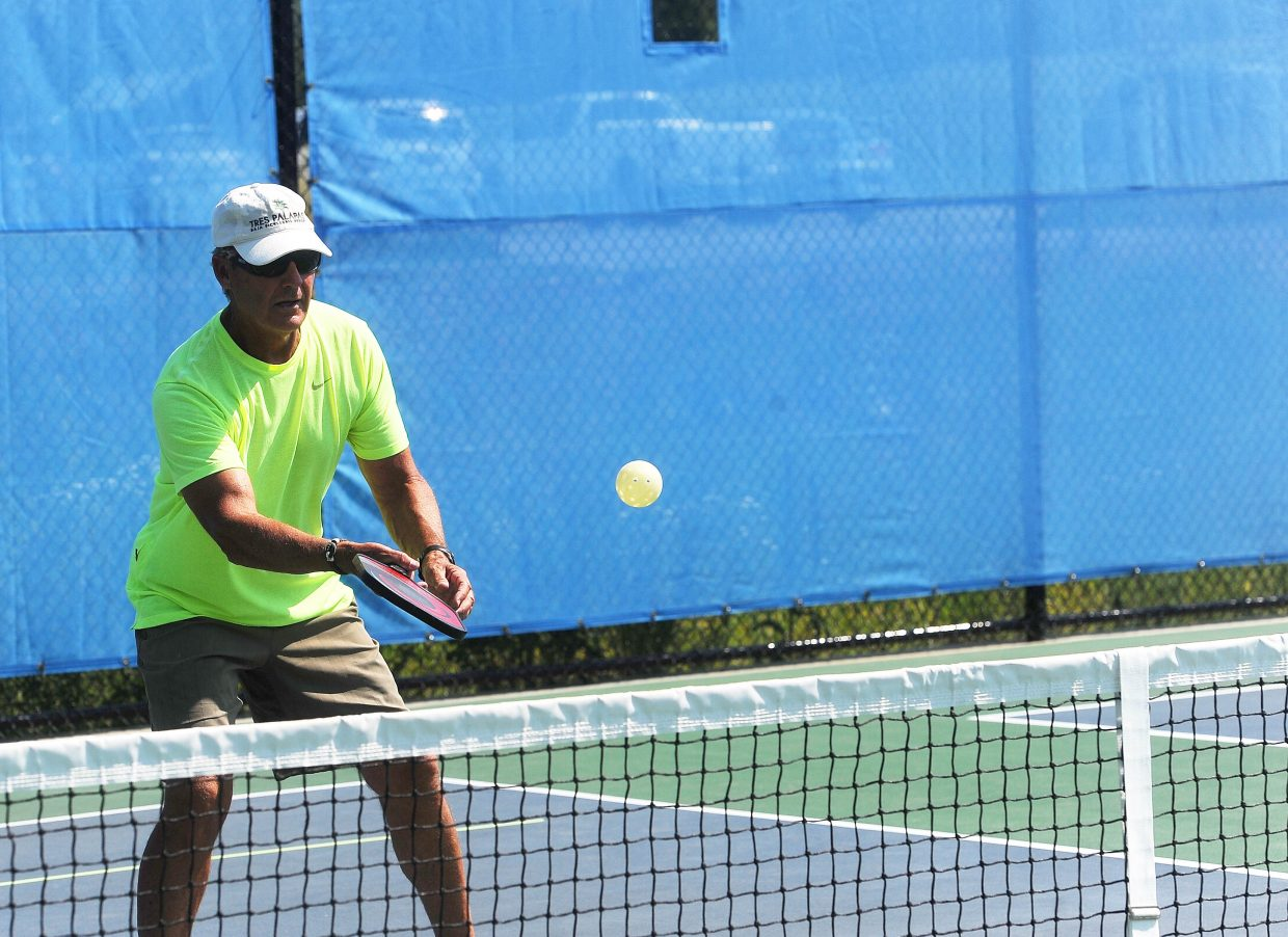 Jon Smalley returns a shot on the court at Scott Moore's pickleball clinic on June 29 and 30.