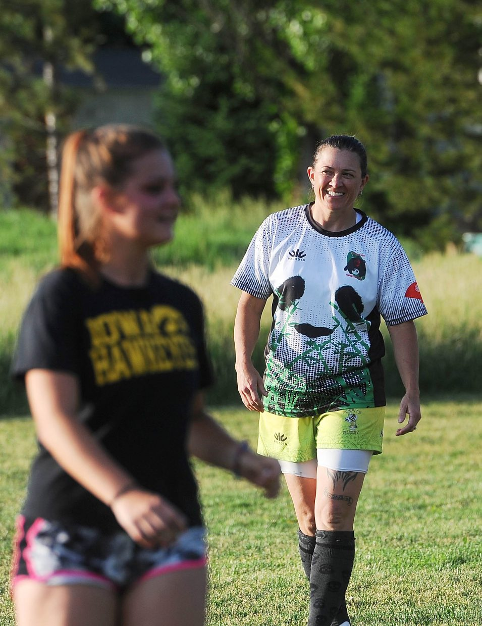 Craig local Angela Poe smiles at rugby practice. She brought Trinitie Beckner (left) to her first practice.