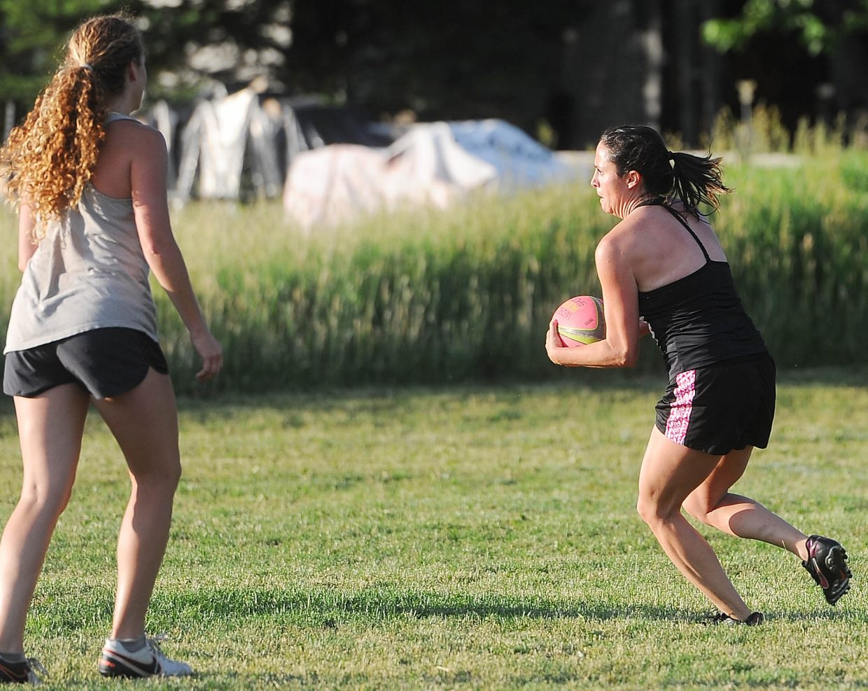 Sarah Tiedeken runs with the ball at rugby practice on Wednesday, June 27.