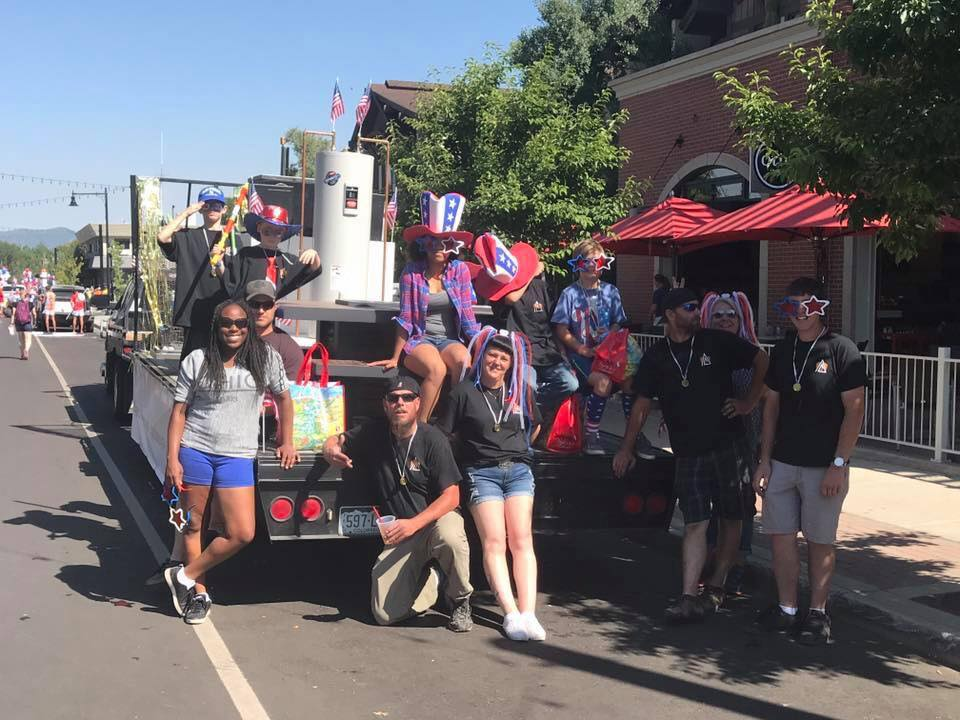 Float riders pause for a photo before the Fourth of July parade gets underway.