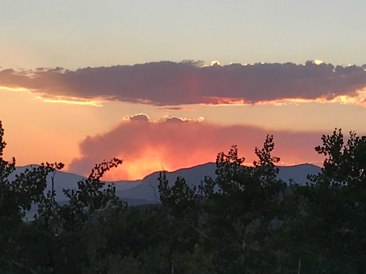 Smoke can be seen over the Sleeping Giant as the sun sets.