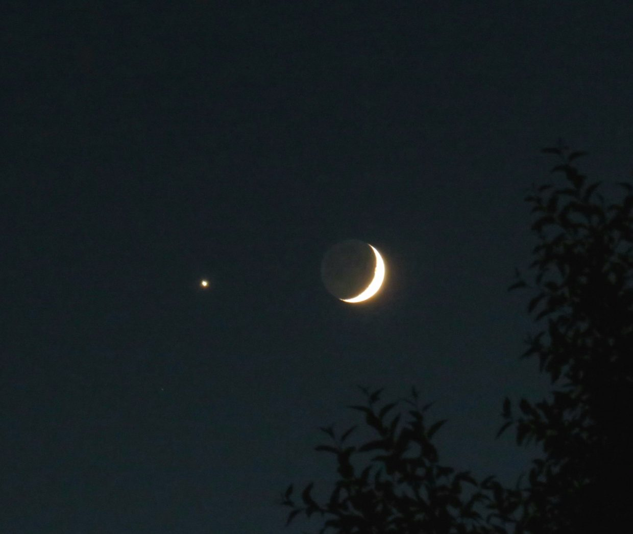 Venus appears in the sky with the moon Sunday on Emerald Mountain.