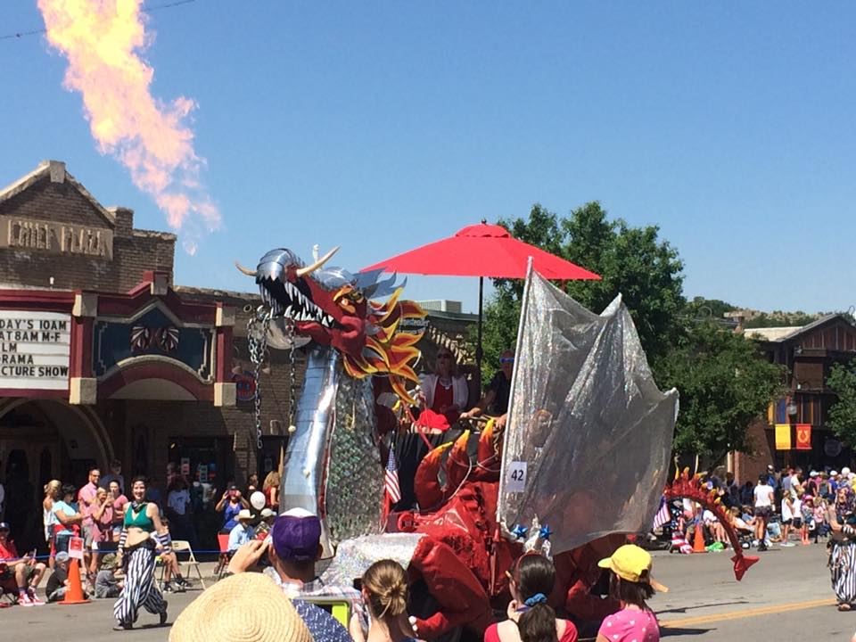 A float shaped like a dragon blows fire during the Steamboat Springs Fourth of July parade.