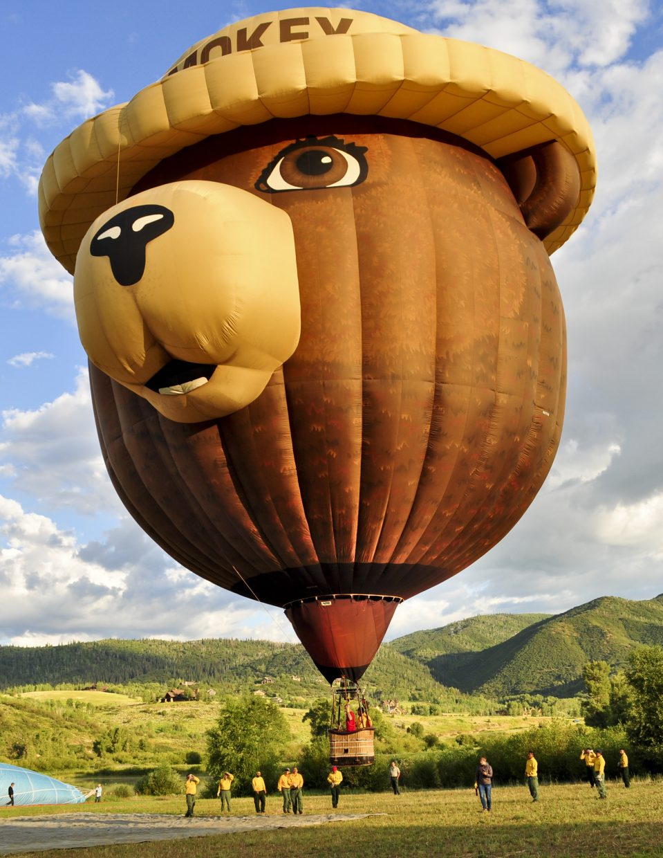 Smokey Bear Balloon is hauled over to a launch spot by a crew of wildland firefighters from Washington who were stationed at the Spring Fire. They were pre-positioned to fight fires while the fire danger was high in Northwest Colorado.