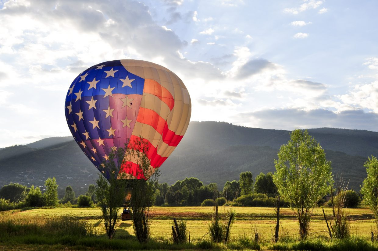 Tim Taylor's Dee 3 hot air balloon gets warmed up for the main event at the Hot Air Balloon Rodeo on Saturday and Sunday at Bald Eagle Lake.