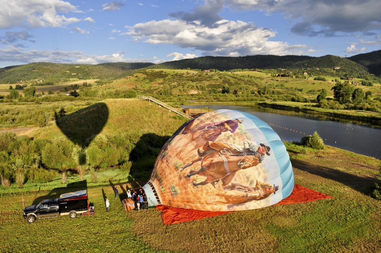 Western Spirit is a hand-painted hot air balloon. The balloon is inflating to take off from Bald Eagle Lake on Friday.