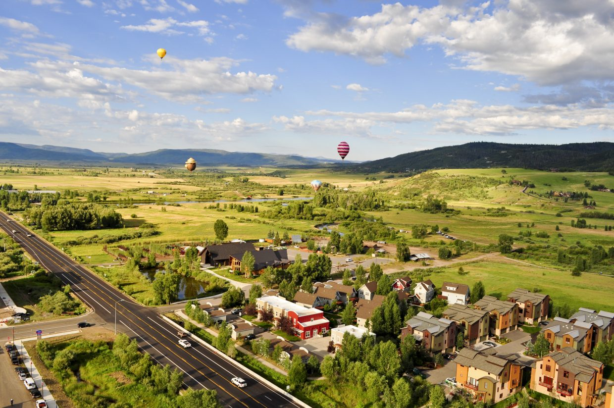 Hot air balloons float over the Yampa Valley early Friday morning. Pilots and crews were out launching at Bald Eagle Lake in preparation for Saturday and Sunday's 37th annual Hot Air Balloon Rodeo in Steamboat Springs.