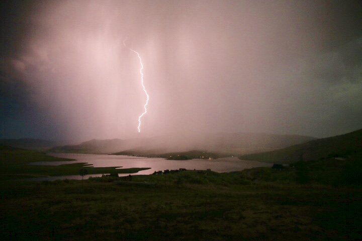 Lightening strikes the top of Stagecoach Lake at dawn.