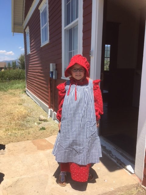 Aline Lillie Hügli, at the Mesa School, is wearing an outfit that her grandma Dawn Lillie made for her Mama when her mother Taryn spent the entire school day at a one-room school house in 4th grade.