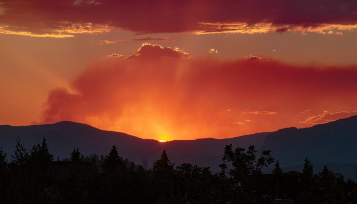 A deep orange sun set takes place on the night of Fourth of July.
