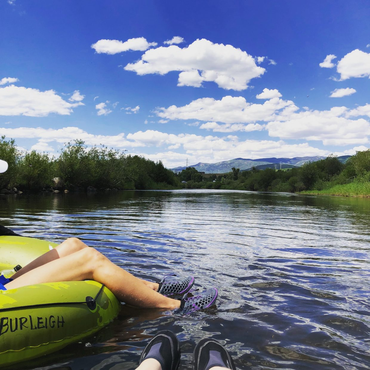 A tuber floats down the Yampa River.
