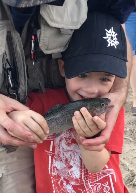 Catch and release at Fetchers Pond. Ethan Petersen's expression is priceless.